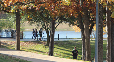 UT Tyler Campus - students walking by lake