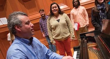UT Tyler Choir Singing with Instructor on Piano
