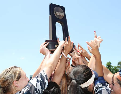 UT Tyler Softball team holding up trophy