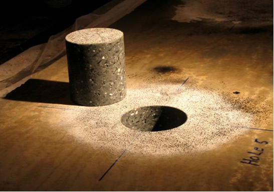Photograph of a concrete plate and associated core after coring (visible is the pattern applied as part of the digital image correlation process)