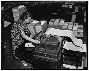 A records keeper with long spool of paper