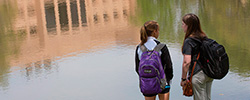 UT Tyler students on campus in front of lake